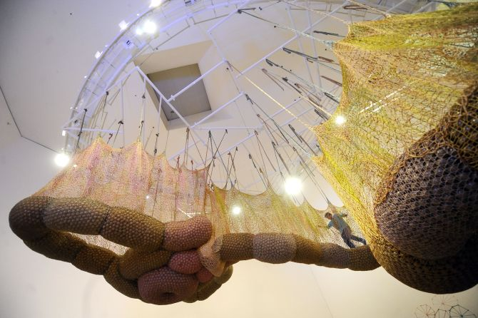 "Ernesto Neto walks in his installation ""Life is a Body We are Part of"". Getty Images"